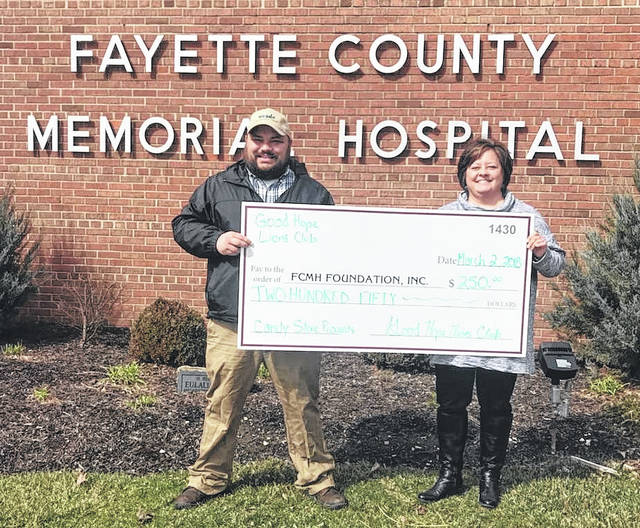 Branen Weade, Good Hope Lions Club president, presents a donation to Fayette County Memorial Hospital Foundation Director Whitney Gentry.