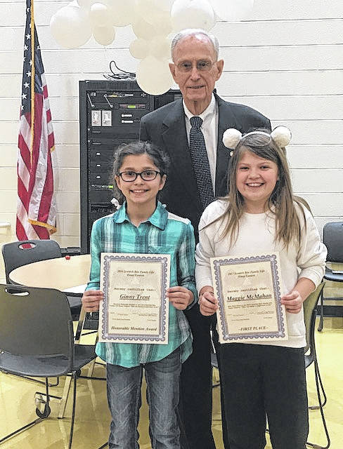 William E. Cupp, with the Scottish Rite, Valley of Columbus, presented Ginny Trent and Maggie McMahon with certificates at Miami Trace Elementary School following the Fayette County Scottish Rite fifth grade essay contest.