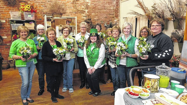 Deer Creek Daisies proudly displaying their shamrock arrangements. Pictured left to right: Billie Lanman, Julie Schwartz, Connie Lindsey, Jeanne Miller, Judy Gentry, Kendra Redd Hernandez, Barbara Vance, Marty Cook, Rita Lanman, Emily King, Shirley Pettit and Joyce Schlichter.