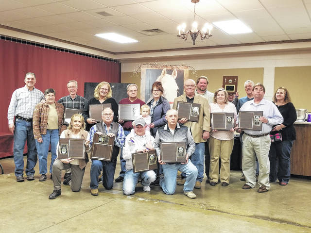 During the recent Fayette County Harness Horseman Association, the 2018 award winners were named. Kneeling (L to R): Carol Cramer, Denny Shaner, Tyler Smith (Maevyn Smith on shoulders) and Jeff Smith. Middle row (L to R): Dean Glispie, Cindy Drake, Dan Drake, Kathy Smith, Jim Everhart, Mrs. Everhart, Jack Redman, Connie Moore, Ron Glover and Vicky Crawford. Back row (L to R): Bret Schwartz, Carol Winters and Gary Crawford.
