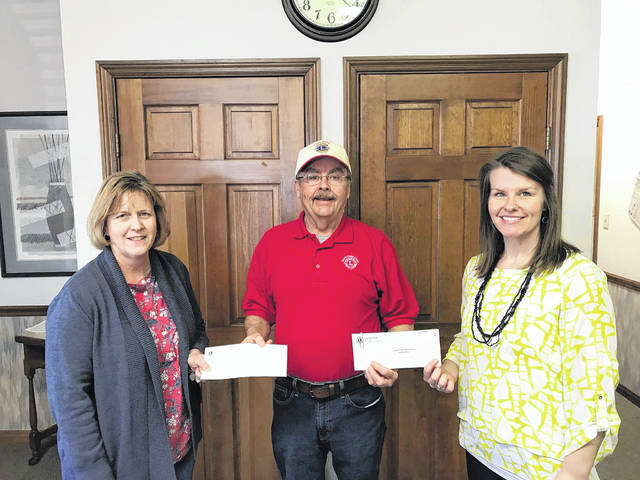 Gary Spears, Good Hope Lions member and Candy Store co-chairman, present scholarship money for local students to Mallory Bihl (right), Miami Trace Local Schools Scholarship Coordinator, and Lisa Hoppes, Washington High School counselor.