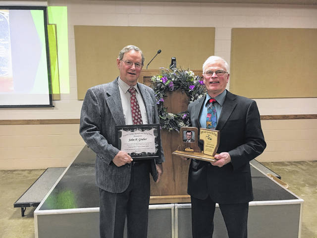 John P. Gruber (left) was also recently inducted into the Fayette County Agricultural Hall of Fame. Jim Garland presented Gruber with the award.