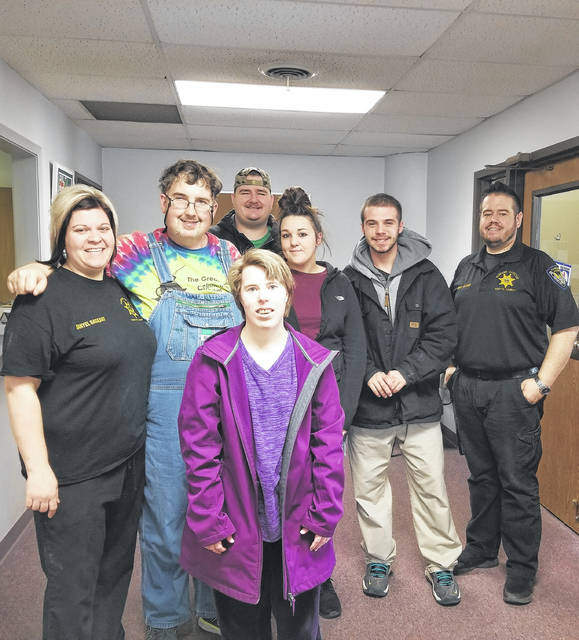 The Personal Center Services of Clinton County recently partnered with the Fayette Regional Humane Society. Pictured (L to R): FRHS Humane Agent and Veterinary Technician Danyel Bageant, PCS group members Frank, Kelsey, Andy, PCS Rep. Emily Wisecup, Austin, and FRHS Outreach Director and Humane Agent Brad Adams.