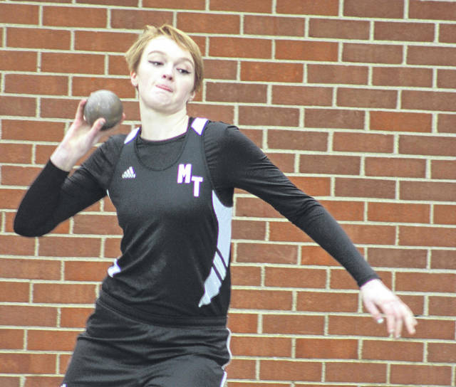 Rachael Campbell competes in the shot put for Miami Trace during the season-opening track and field meet against Wilmington and Clinton-Massie Tuesday, March 27, 2018.