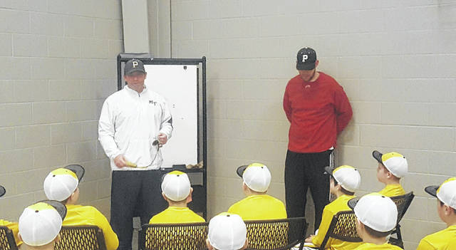 Miami Trace head baseball coach Rob Smith, left, and assistant Matt Platt, speaking to the 11u Panthers Baseball Club Monday evening, March 5, 2018, on what it takes to be an athlete: good grades in school, be responsible, be respectful, be coachable, be disciplined, work hard/hustle, and be healthy.