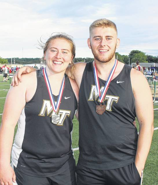 Katie Seyfang and her brother, Wes Seyfang, are pictured at the Regional track meet at Athens High School May 26, 2017.