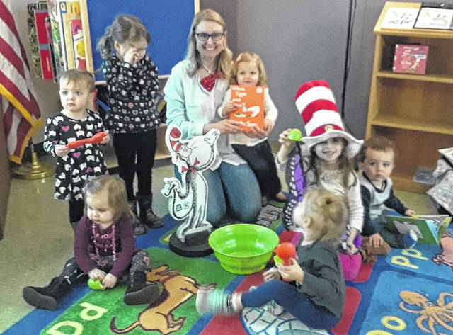 "Children celebrated Dr. Seuss's birthday by reading ""Green Eggs and Ham"" with Miss Noel at Books and Blocks storytime."