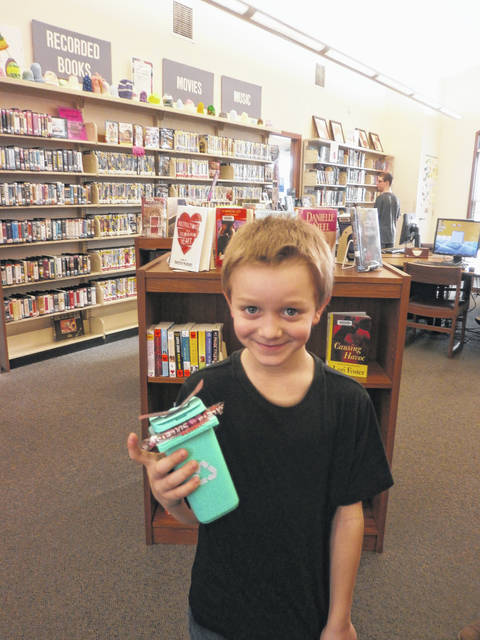 Ian Kuhn was the latest winner of Susan's Secret Sweets by guessing the correct amount of candy in the container at Jeffersonville Branch Library. Congratulations, Ian.