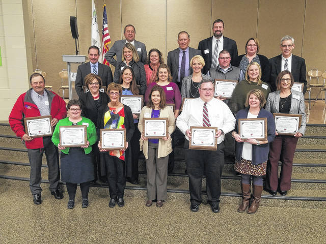 The Southern Ohio Educational Service Center hosted its 21st-annual Four-County Board and Dinner Meeting on March 20 with Board of Education members, administrators, and honored guests from Adams, Clinton, Fayette, and Highland Counties among those in attendance. Pictured (L to R): first row: Lisa Beresford, Margie Eads Walker, Stacy Camp, Jason Jones and Jennie Pierson. Second row: Doug Hauke, Shelly Bailey, Jennifer Updike, Melanie Ohnewehr, Kara Williams, Michael Snider, Kristin Unversaw and Mindy McCarty. Last row (row three and four blended): Eric Wayne, Michael Bick, Maggie Lyons, Alana Walters, Tim Walters, David Lewis, Angela Godby and Rich Seas.