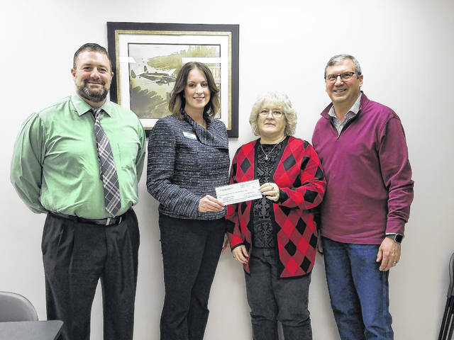 Last year the Fayette County Park District Board wrote letters of intent to offset the expense of the local share requirements toward grant applications. Recently, the board was able to do just that and awarded the village of Bloomingburg $5,000. Pictured (L to R): David Lewis, Angie Tackett, Bloomingburg Mayor Gayle Brown and Dan Stahl.
