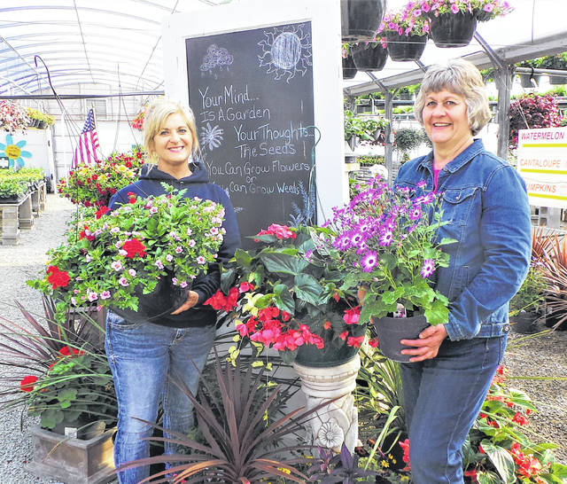 Members and guests of Altrusa International of Washington C.H., Inc., enjoyed an outing to Patchwork Gardens Greenhouse for the April program meeting. Planting design tips were presented by Stacey Wilt, owner of the local greenhouse operation now in its 35th year. She also offered a generous discount to those Altrusans who were interested in starting their shopping for spring and summer flowers, and asked some of her employees to stay on after normal closing hours to advise the private group of several dozen women. Shown are (from left) Patchwork Gardens owner Stacey Wilt and Altrusan (and part-time employee) Janet Martin.
