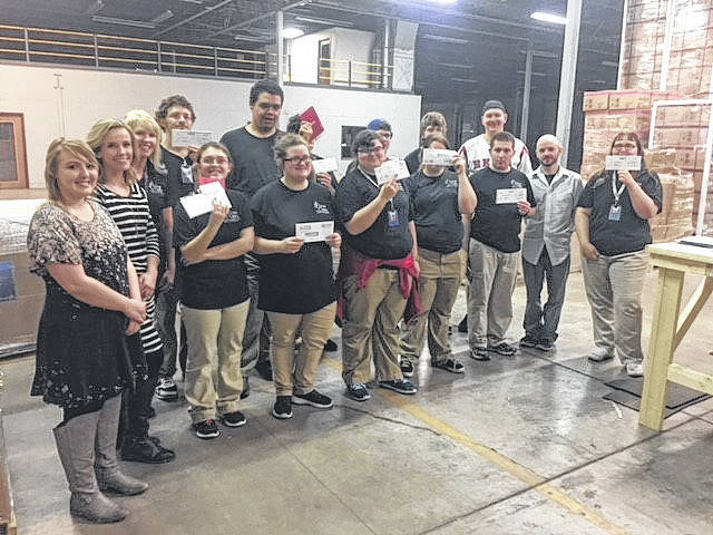 CareerX students showing off their first paychecks.