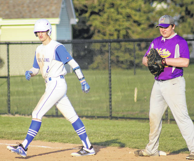 Eli Lynch gets a walking lead at first base for the Blue Lions during a Frontier Athletic Conference game against the McClain Tigers Wednesday, April 11, 2018 at Washington High School.