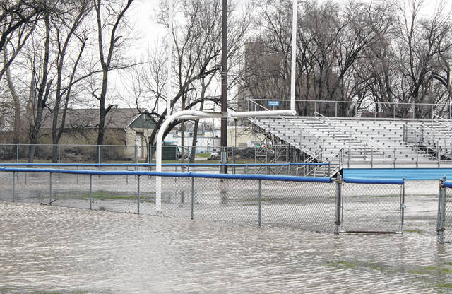 The football field at Gardner Park, home of the Washington Blue Lions, became at least partly submerged by the rising waters of Paint Creek Wednesday afternoon. After experiencing temperatures in the mid to upper 60's Tuesday, it felt much more like winter Wednesday, as continued gusting winds sent a chill across Fayette County.