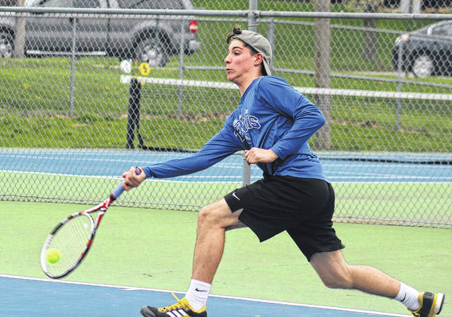 Grant Kuhlwein makes the return for the Blue Lions during a non-league match against Waverly Wednesday, April 18, 2018 at Gardner Park. Kuhlwein won his third singles match, 6-0, 6-2.