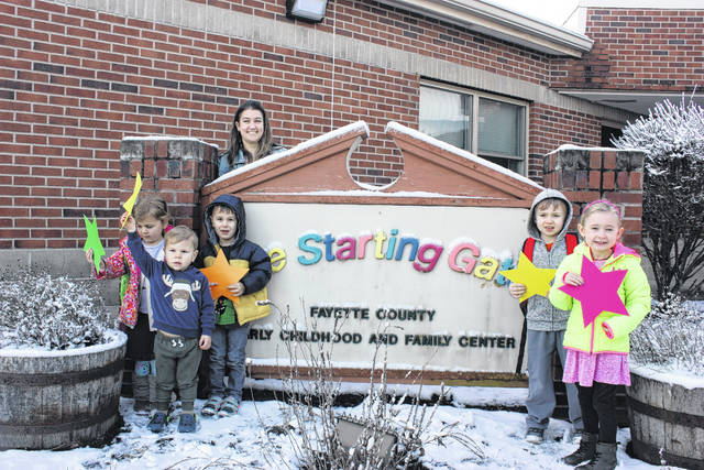 Fayette Progressive Preschool recently received a five-star rating from the Ohio Department of Education's Step Up to Quality Rating system. Pictured are Violet Sims (green star), Declan Sims (orange star), Sawyer Sims (yellow star), Austin Davis (yellow star), Riley Stewart (pink star), with Jamie Roe behind the sign.