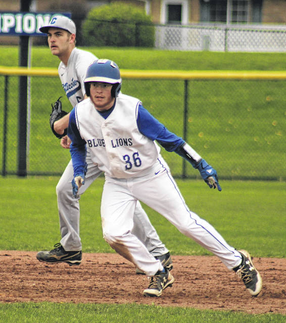 Washington's Jarred Hall gets a lead off second base during a Frontier Athletic Conference game against Chillicothe Wednesday, April 18, 2018 at Washington High School.