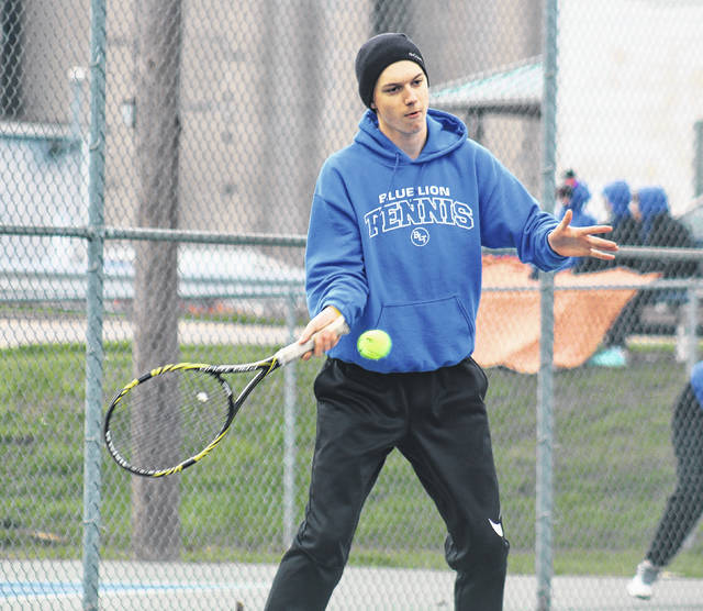 Jordan Behm returns a shot at first singles for Washington on a cold Monday, April 9, 2018 at Gardner Park against visiting Gallia Academy.
