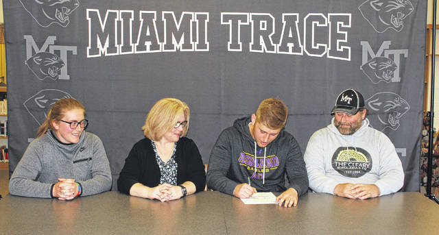 Miami Trace High School senior Wes Seyfang, third from left, signs a letter of intent to attend Ashland University on April 17, 2018. The ceremony was held in the high school's library. Seyfang is joined by (l-r); his sister, Katie, and mom and dad, Ricky and Mike.