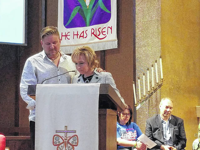 Rob and Kim Pittser pray for education on Thursday afternoon during the National Day of Prayer held at Grace United Methodist Church. Residents gathered from all over the community to pray for the issues facing Fayette County and the United States. Look for more photos of the event inside.