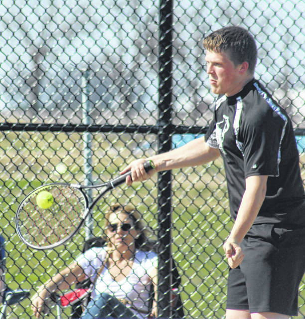 Miami Trace's Adam Ginn volleys during a first doubles match (along with partner, Johnathan Allen) against the Blue Lions Tuesday, May 1, 2018 at Miami Trace High School.