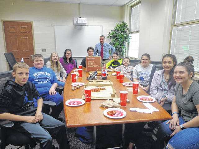"""Donatos recently provided pizza to these students at Washington Middle School as they celebrated """"Pizza with the Principals."""" This is in appreciation for their selection as Students of the Month for April. They are chosen by their teachers because of the outstanding example they set for their peers in such areas as academic effort, good work ethic, kindness to others, and service to their school. Pictured (L to R): Christian Scott, Logan Miller, Natalie Truex, Stephany Matheny, Jayden Mitchell, (Mr. Montgomery, Asst. Principal) Jackson Powell, Domanik Mongold, Dakota Amburgey, Gabby Gonzalez and Savannah Osborne."""
