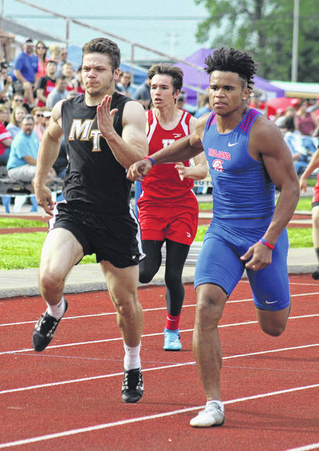Brady Wallace runs in a semifinal of the 100-meter dash for Miami Trace during the Division II District meet Tuesday, May 15, 2018.