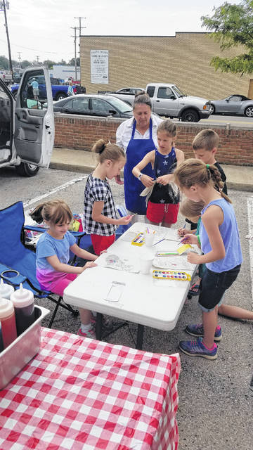 Children with water colors at the Fayette County Farmers' Market.