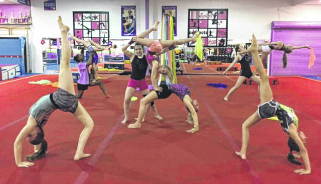 Tric's Gymnasts are shown practicing and perfecting their performances for the Recital to be held at Miami Trace High School. The annual recital is Saturday at 2 p.m. and 5:30 p.m.