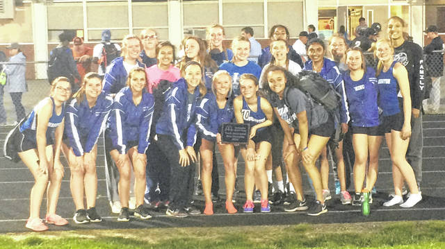 The Washington Lady Blue Lion track team poses with their team trophy after winning the Miami Trace Invitational Thursday, May 3, 2018.