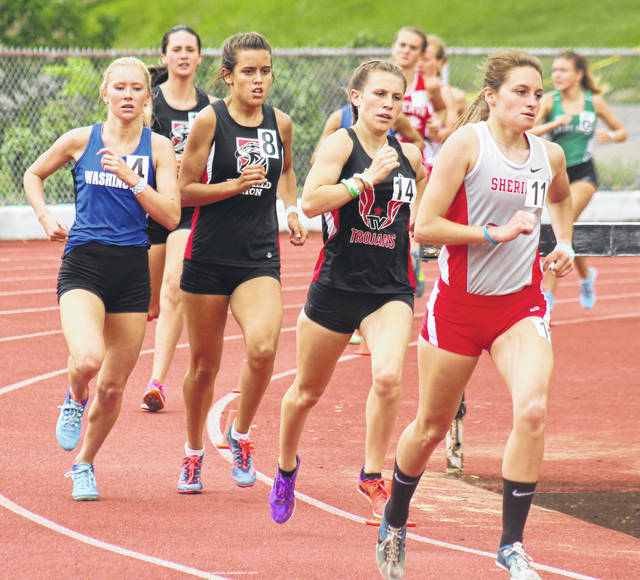 Washington's Maddy Garrison, at left, ran a new school record time of 5:14.40 in the 1600-meters at the Regional meet in New Concord to qualify to the State meet where she will run Saturday at 1:35 p.m.