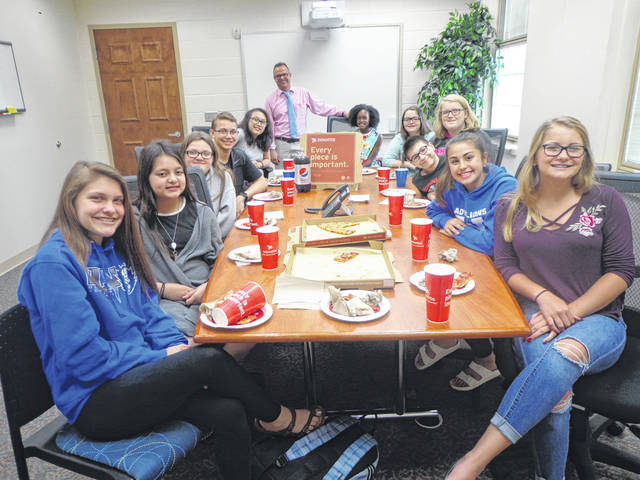 "Donatos recently provided pizza to these students at Washington Middle School as they celebrated ""Pizza with the Principals."" This is in appreciation for their selection as Students of the Month for May. They are chosen by their teachers because of the outstanding example they set for their peers in such areas as academic effort, good work ethic, kindness to others, and service to their school. Pictured (L to R): Ellie Lynch, Mya Perez, Racine Grim, David Surina, Jenteal Larson, Mr. Montgomery, assistant principal, Kierstyn Mitchell, Mayleigh Koutz, Lorelei Taylor, Parker Foy, Aaralyne Estep and Kassidy Olsson. Absent from the photo were Scottie Forsha and Maggie Copas."
