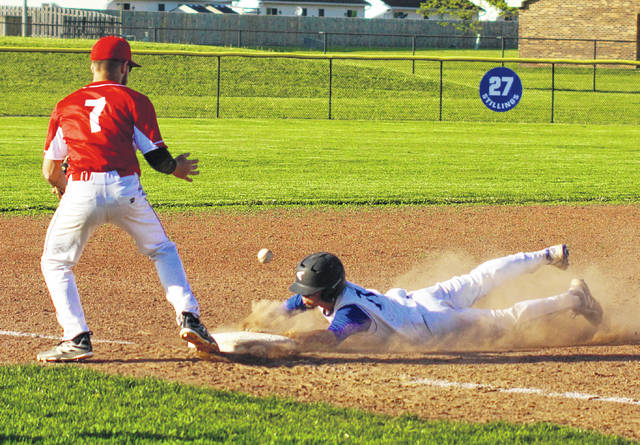 Nick Barrett slides into third base with a triple for Washington during a Division II Sectional championship game against Hillsboro Thursday, May 10, 2018 at Washington High School.