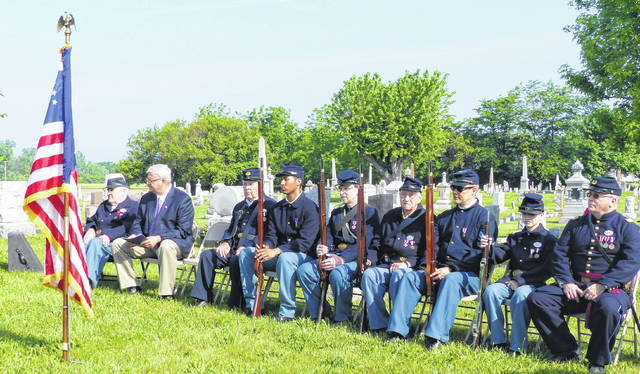 Fayette County Commissioner Dan Dean sits with members of Co. C, 20th Ohio Volunteer Infantry Sons of Veterans Reserve waiting to give the Memorial Day address at the Bloomingburg Cemetery.