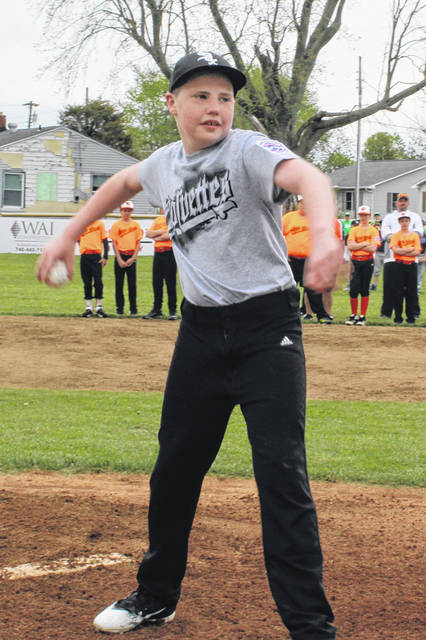 Andrew Ingram-Shaw of the Corvettes throws out the ceremonial first pitch for the Washington C.H. Little League Opening Day Saturday, May 5, 2018.