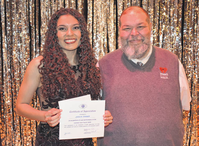 Winner of the 51st Kiwanis Teen Talent Show Jocelyn Trimmer of Washington High School is pictured with Master of Ceremonies Harry Wright after the winners were named.