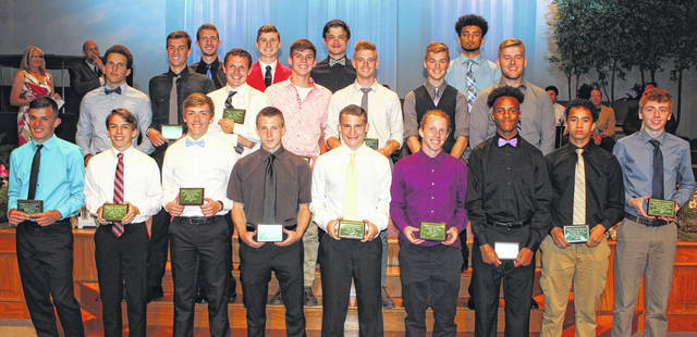 The Frontier Athletic Conference honored its top track and field athletes for 2018 at the conference's first-ever spring sports banquet on May 21. All of the above student-athletes won their respect events to earn First Team, All-FAC recognition. In the front row, fifth from left, Noah Wiseman of Miami Trace, the 200-meter dash champion; in the middle row, at left is Washington's Caleb Rice, 110-meter hurdle champion; in the middle, second from right is Miami Trace's Jaden Haldeman, 300-meter hurdle champion and next to him is Miami Trace's Wes Seyfang, discus throw champion. In the back row, the first person on the left is Washington's Brandon Underwood, 800-meter champion.