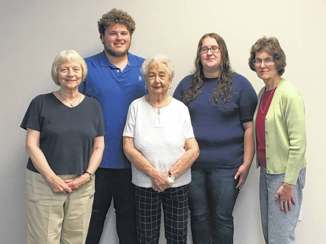 Aaron S. Turner and Brittany Fraysier were two of the three recipients of scholarships from the FCMH Auxiliary. The other scholarship winner, John Fender, was not present for the photo. Turner and Fraysier are pictured with members of the FCMH Auxiliary scholarship committee.