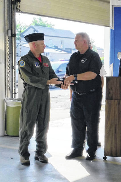 Lt. Col. Robert L. Cruea presenting a flag to Fayette County EMS Director Rod List at Saturday's flag presentation and dedication.