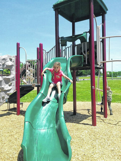 Jordyn Lawson had a great time Wednesday at Christman Park in Washington Court House. Here, she decided to give the playground slide a whirl.
