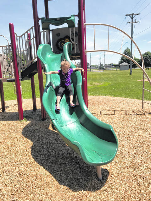 Kymber Helton enjoyed the beautiful weather Wednesday afternoon by going down the slide at Christman Park in Washington Court House.