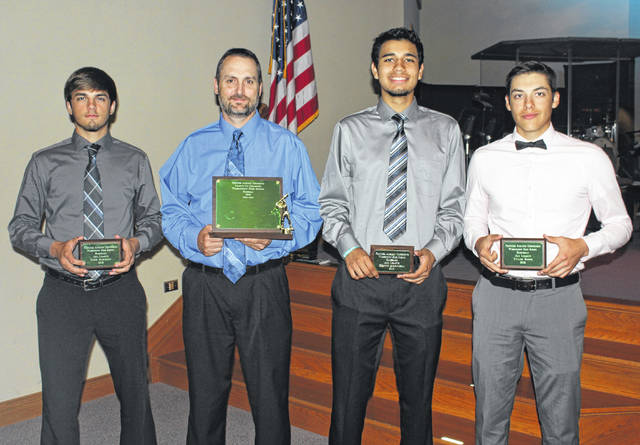 First Team members of the Washington Blue Lion baseball team were on hand to receive their plaques as well as the championship trophy for their 2018 co-championship at the Frontier Athletic Conference's spring sports banquet held May 21. (l-r); Nick Barrett, head coach Mark Schwartz, Kenny Arboleda and Tyler Rood.