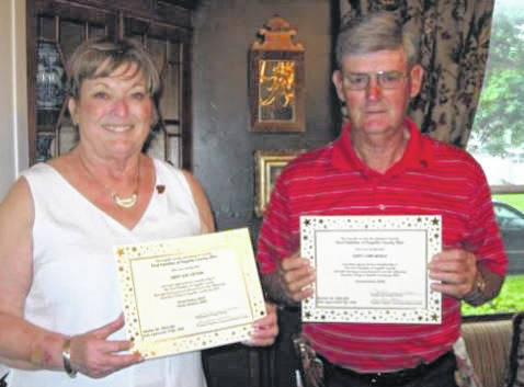 Cindy Cotton Brady and Gary Mickle received their certificates and pins for being inducted into The First Families of Fayette County Linage Society.