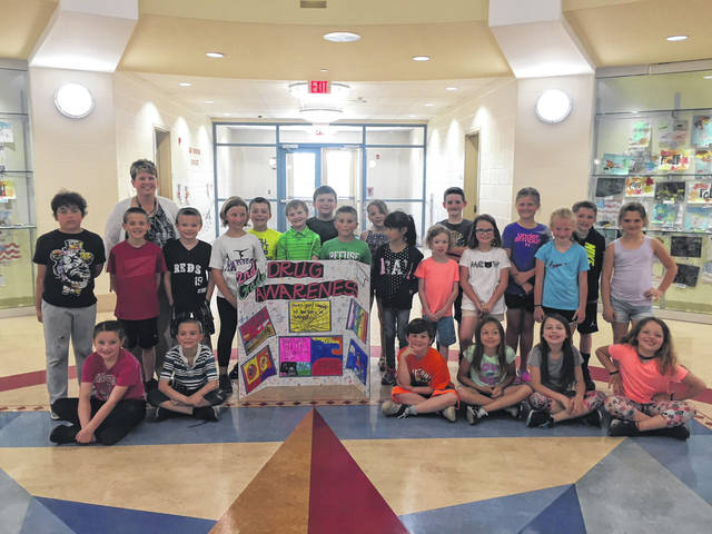 Mrs. Carter's second grade class centered its service learning project on a drug awareness campaign.
