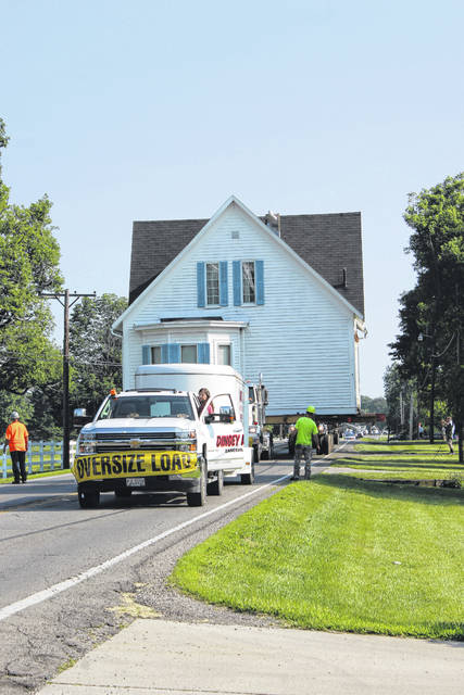 The historical Robinson-Pavey home, which was featured in the Friday, Aug. 25, 1978 edition of the Record-Herald, was moved on Sunday morning on State Route 41 with a crowd of onlookers. Even after three hours of moving, the crew was far from the finish line. The home will finish its journey this Sunday morning.