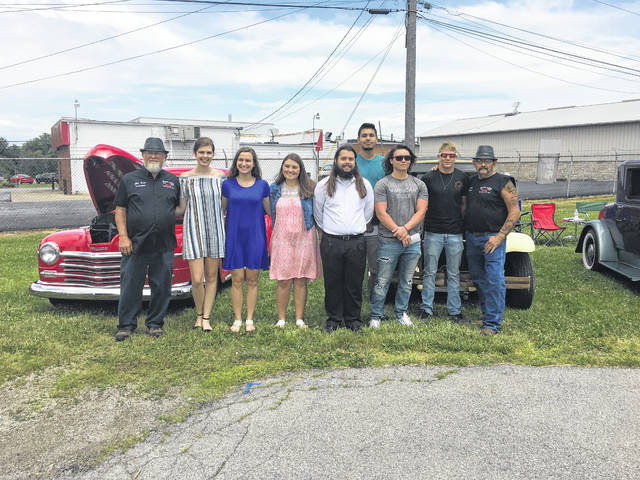 Dragin' Angel scholarship recipients include from left to right: Marie Pickerill, Haley Copas, McKensie Riley, Gabriel Bridges, Kenneth Arboleta-Munoz, Philip Darion Streitenberger and Silas Gray. They are flanked by club vice president Jim Moore and president Matt Gray.