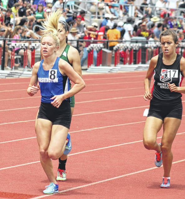 Maddy Garrison, at left, runs in the 1600-meter event at the State track meet Saturday, June 2, 2018 at Jesse Owens Memorial Stadium on the campus of The Ohio State University.