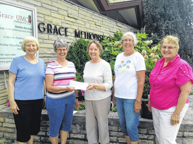 Members of Court House Quilters recently donated a portion of the proceeds from their May quilt show to The Backpack Program at Grace United Methodist Church. Left to right, Joyce Lott and Leslie Teeter of GUMC and quilters Bobbie Long, Beth Foster and Colleen Downing.