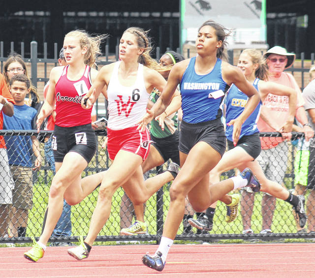 Washington's Rayana Burns, at right, runs the turn in the finals of the 400-meter dash at the Division II State track meet Saturday, June 2, 2018 at Jesse Owens Memorial Stadium on the campus of The Ohio State University in Columbus. Burns placed third in a time of 57.08. At left is Orrville sophomore Sedona Goodard, who placed sixth and next to Burns is senior Megan Braun of Van Wert, who placed fifth.