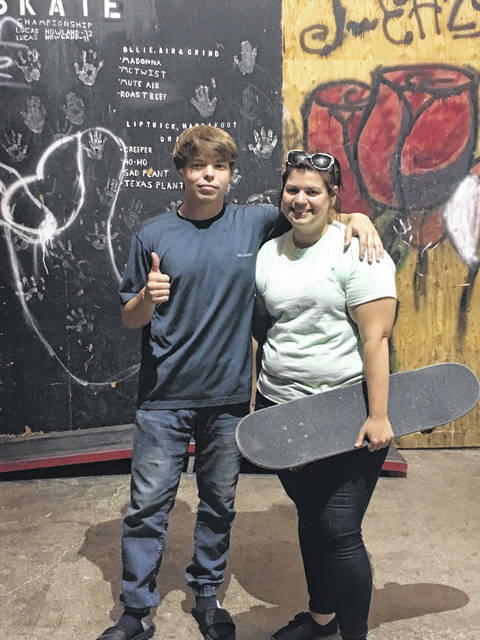 Volunteer Brandon Campbell and director Abby Fitch work together to provide a safe place for kids in the community to have fun and be themselves.